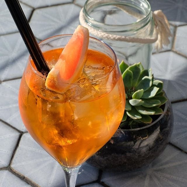 A tough way to spend an afternoon – new menu testing and Aperol Spritz on the balcony at Bib & Tucker!